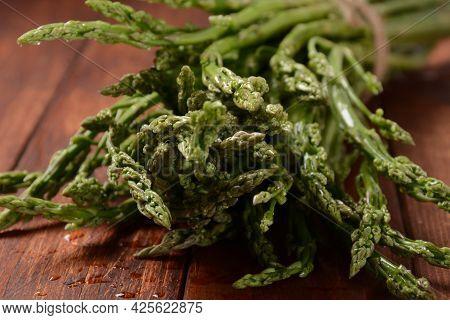 Asparagus. Fresh Green Asparagus On Wooden Table Background. Bunch Of Fresh Ripe Green Asparagus Org