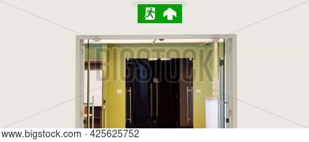 Green Emergency Fire Exit Sign Or Fire Escape With The Doorway Or Door Exit In The Building Concepts