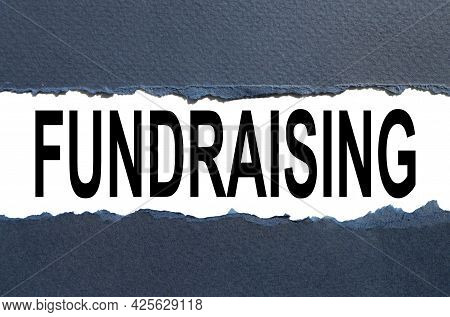 Fundraise. Text On Torn Paper. Test In Black Letters
