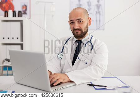 Portrait Of Specialist Physician Man Looking Into Camera Working In Meeting Conference Room Analyzin