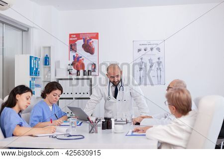 Therapist Doctor With Stethoscope Explaining Healthcare Treatment Discussing Medical Expertise Prese