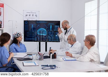 Neurologist Showing Digital Radiography To Medical Coworkers Analysing Brain Illness Presentation Us