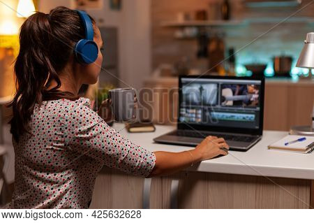 Professional Colorist Working In Video Footage During Post Production. Content Creator In Home Worki