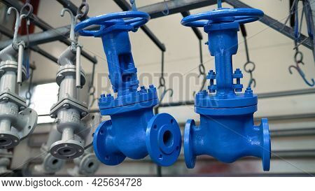 Pipes And Valves With Blue Handles For Water. Production Of Water Valves. Blue Water Valves.