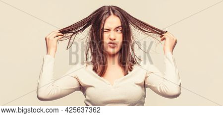 Woman Having A Bad Hair, Her Hair Is Messy And Tangled. Messy Hair. Brunette Woman With Messed Hairs