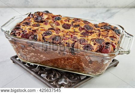 Ready Cherry Pie, Clafoutis In Baking Dish On Stand On The Table