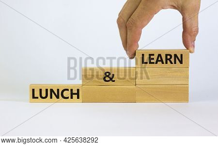 Lunch And Learn Symbol. Wooden Blocks With Concept Words Lunch And Learn. Beautiful White Background