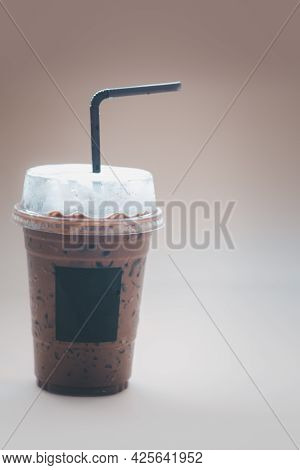 Iced Mocha Coffee In Plastic Cup With Blank Logo On Glass