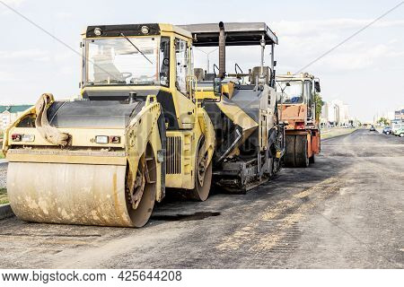 Asphalt Paving Equipment. Asphalt Paver And Heavy Vibratory Roller. Construction Of New Roads And Ro