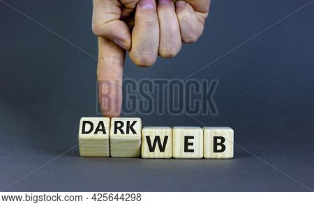 Dark Web Symbol. Businessman Turns Wooden Cubes And Changes The Word Web To Dark Web. Beautiful Grey