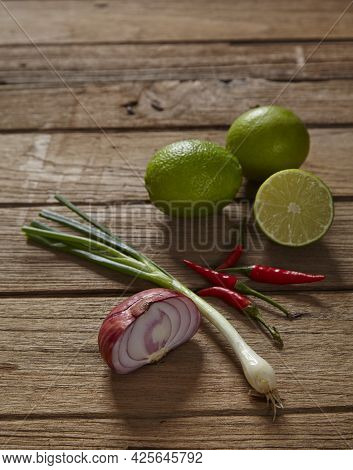 Ingredients Set For Thai Spicy Soup (tom-yum) Include Lemon, Red Chili ,red Onion Lemongrass And Gre