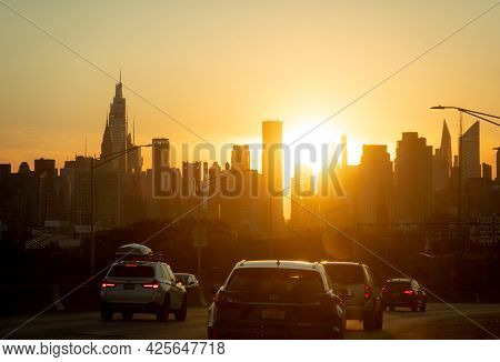 New York City, New York - June 24, 2021: The Bright Evening Sun Shining Through The Skyscrapers In T