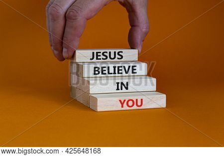 Jesus Believe In You Symbol. Concept Words 'jesus Believe In You' On Wooden Blocks On A Beautiful Or