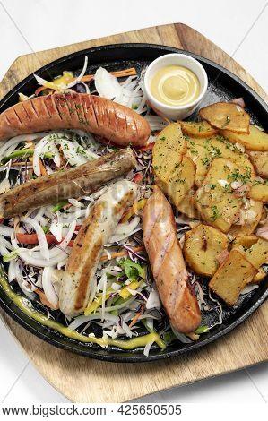 Mixed German Traditional Organic Sausage And Potato Meal Platter Including Nurenberger, Lamb And Por