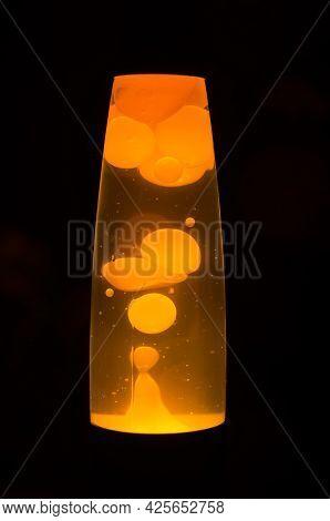 Orange Lava Lamp Bubbles On A Black Background
