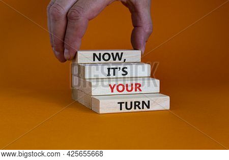 Now, It's Your Turn Symbol. Wooden Blocks Form The Words 'now, It's Your Turn' On Beautiful Orange B