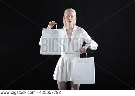 White Caucasian Albino Blond Woman Holds Shopping Bag. Sale And Discounts On Market And Black Friday