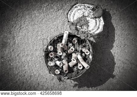 Cigarette Butts In An Old Dirty Tin Can. Smoking Is A Bad Habit That Many People Fall Ill With. Conc