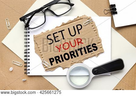 Set Up Your Priorities. Text On Torn Cardboard On Craft Background