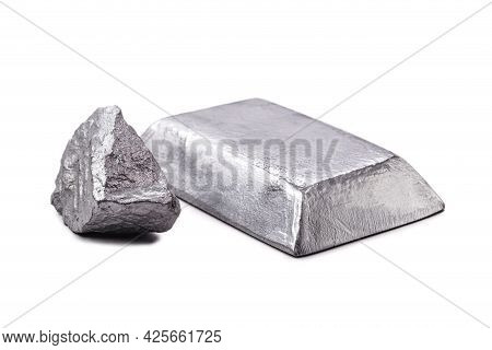 Isolated Zinc Ingot Or Bar Next To Raw Zinc Nugget On Isolated White Background, Metal Used In Alloy