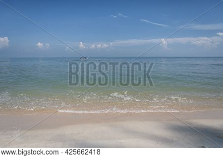 The Malacca Straits At Long Beach At Batu Ferringhi On A Summer Day On Penang Malaysia.