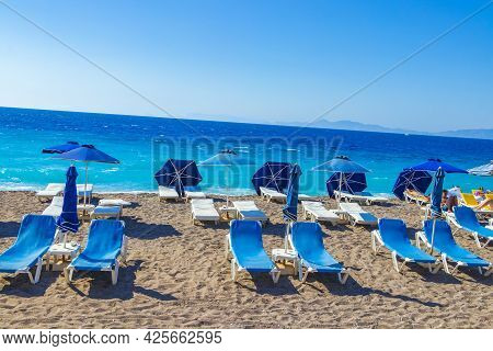 Rhodes Greece 21. September 2018 Relax On Blue Sun Loungers At Vacation In Rhodes Greece With Beauti