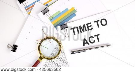 Time To Act Text On White Paper On Light Background With Charts Paper