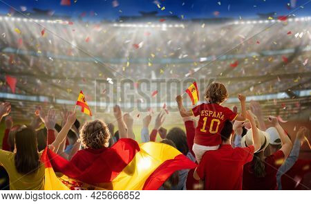 Spain Football Supporter On Stadium. Spanish Fans On Soccer Pitch Watching Team Play. Group Of Suppo