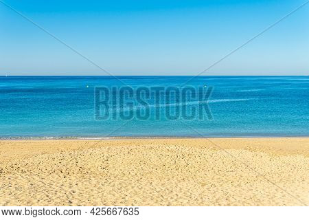 General View Of Can Pere Antoni Beach With The City Of Palma De Mallorca In The Background At Sunris