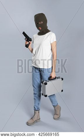 Woman Wearing Knitted Balaclava With Metal Briefcase Gun On Grey Background