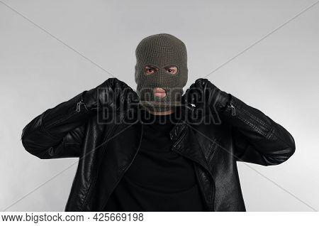Man Wearing Knitted Balaclava On Light Grey Background