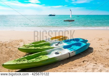 Tropical Landscape At Koh Kood Is A Tropical Island And Tropical Beach With Kayak Amidst Emerald Gre