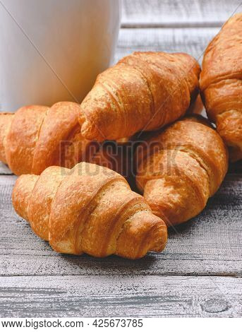 Homemade Croissant Served With Black Coffee Or Americano. Delicious Breakfast With Fresh Croissant A