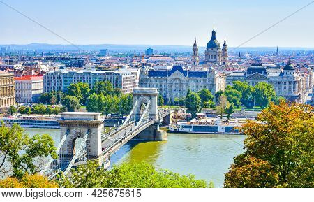 Famous Chain Bridge Across The Danube River In Budapest, Hungary. Cityscape Panoramic View Of Old Ci