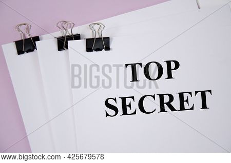 Top Secret Concept Written On White Piece Of Paper And Pink Background