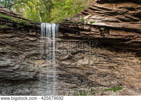 Water Flowing Over The Cliff Edge At Ozone Falls In Tennessee As The Water Flows Into The Pool Below