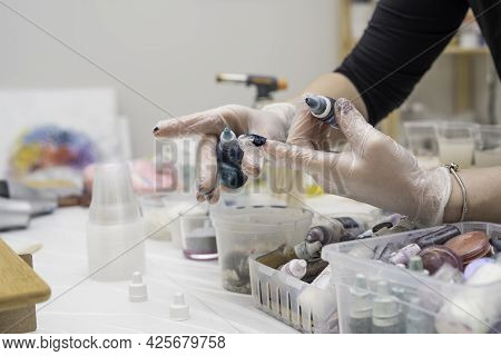 Artist Stains A Disposable Transparent Glove With A Drop Of Colored Dye (pigment) For Creativity, To