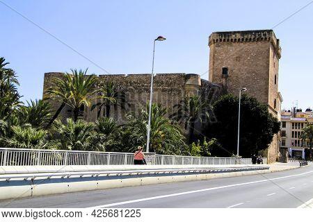 Elche, Alicante, Spain- July 2, 2021: Beautiful Altamira Palace And Altamira Bridge Next To Lush Lan