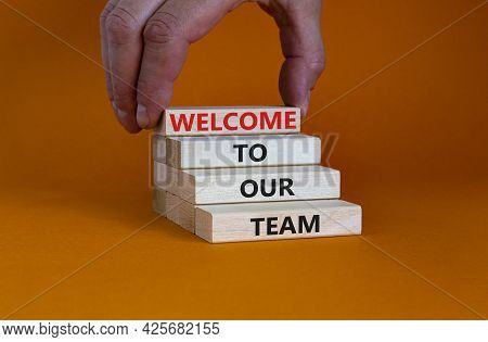 Welcome To Our Team Symbol. Wooden Blocks With Words 'welcome To Our Team' On Beautiful Orange Backg