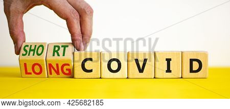 Long Covid Symbol. Doctor Turnes Wooden Cubes And Changes Words ' Long Covid' To 'short Covid'. Beau
