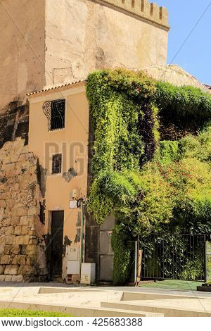 Elche, Alicante, Spain- July 2, 2021: Tourist Visiting Calahorra Tower With Its Wonderful Vertical G
