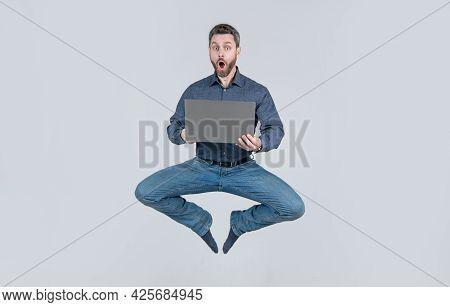 Surprised Energetic Jumping Man Businessman While Working Online On Laptop, Sale