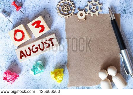 August 3. Date Of August Month. Number Cube With A Flower And Notebook On Diamond Wood Table For The