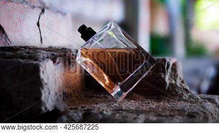 Men's Perfume In A Jar On Old Bricks.
