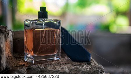 Men's Perfume In A Jar On Old Bricks. Spirits On The Background Of Ruins.