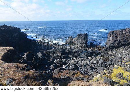 Scenic Black Lava Rock Beach In Coastal Iceland.