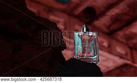 Perfume For Men On Antique Bricks In Bright Colors Of Red. A Bottle Of Men's Perfume.