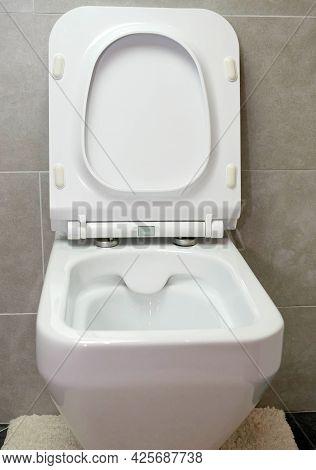 White Toilet Bowl Close-up. Modern Toilet.  Close Up