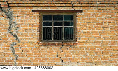Brick Wall With A Crack, A Window In An Old House, The Texture Of An Old House Made Of Red Bricks.