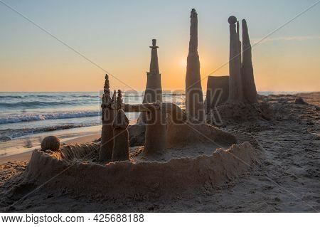 Sand Castle On Beach. Built House Sand Castle With Towers On The South Shore Of The Sandy Beach Blue
